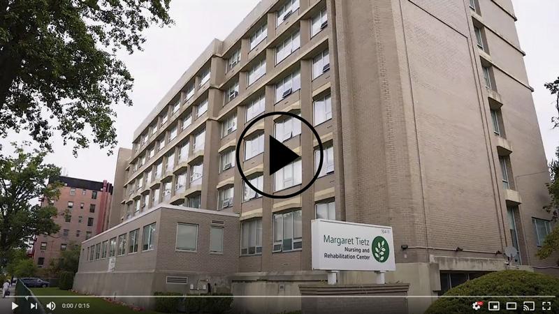 Video player mockup including image of Margaret Tietz building