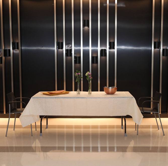 Beautiful table setting in front of black wall